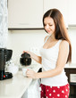 Beautiful girl making coffee
