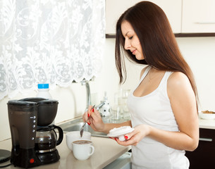girl making coffee for breakfast.