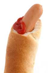European hotdog in a crispy bread roll and with ketchup