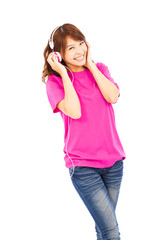 happy young girl listening and holding the earphone