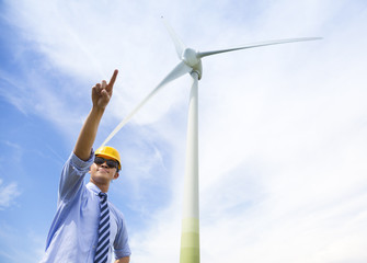 professional engineer raise his finger with wind generator