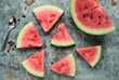 Pieces of watermelon on a  metal board