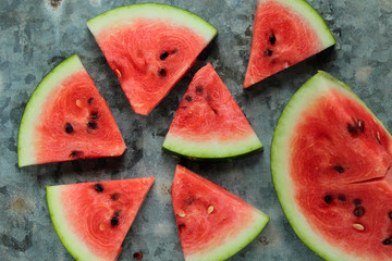 Fresh watermelon pieces on a metal board