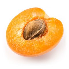 Apricot. Half of a fruit isolated on white