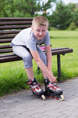 little boy on roller skates