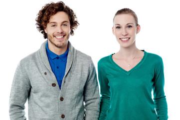 Smiling fashion couple posing together