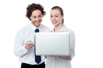 Happy business people  browsing on a laptop