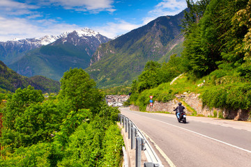 Motorcyclist riding in the Switzerland Alps.