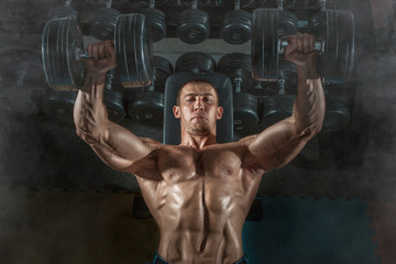 bodybuilder dumbbell presses