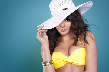 Sexy woman hiding behind white hat