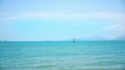 Windsurfing on a Clear Day in a Blue Sea. Thailand.