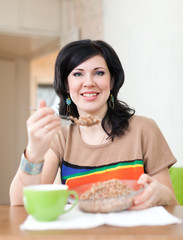 Beautiful  woman eats buckwheat