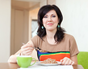 woman eats buckwheat cereal