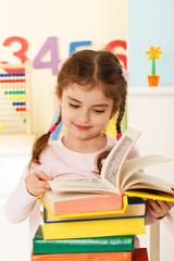 little girl reads