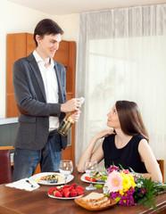 Man opened sparkling wine and having romantic dinner