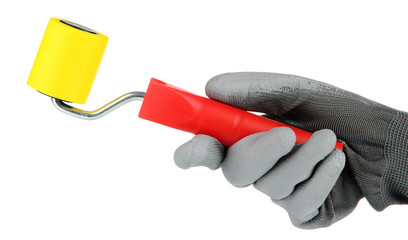 Bright paint roller in hand isolated on white