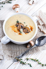 Champignons mushroom soup on a wooden board