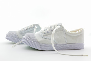 Pair of white sport shoes.
