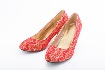 Beautiful chinese embroidered wedding shoes isolated on white