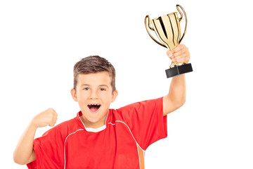 Overjoyed boy holding a gold cup