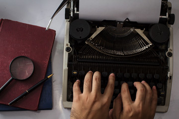 Typing with typewriter,top view.