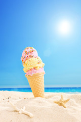 Ice cream stuck in sand on a sunny tropical beach