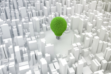 3d image of light bulb and city, green energy concept