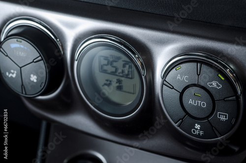 Color detail with the air conditioning button inside a car - 66702834