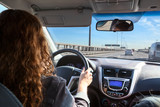 Woman driving car on highway, inside view