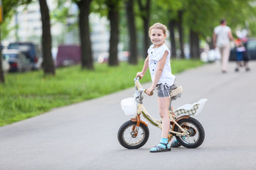 Small Caucasian girl riding a bicycle