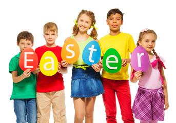 Children hold egg shape colourful cards together