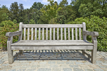Wooden park bench in the garden