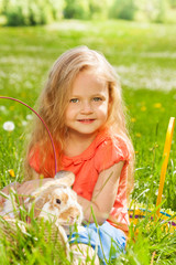 Little girl with rabbit in the basket