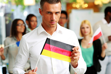 Confident businessman holding flag of Germany