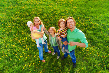 Smiling family portrait from above in park