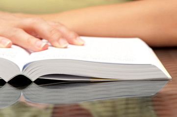 Woman hands holding open book
