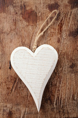 white wooden heart on old wooden background