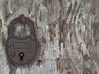 vintage padlock on a old door
