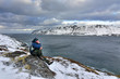 Man enjoy the Norwegian sea coast nature