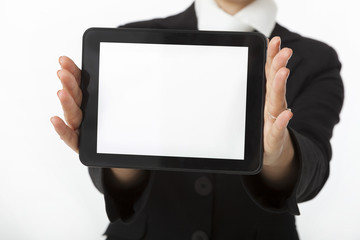 Businesswoman is showing digital tablet screen