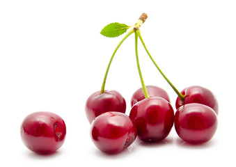 Juicy cherry with leaf isolated