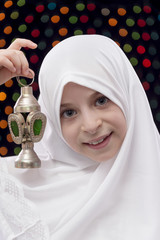 Young Girl in White Hejab Holding Ramadan Lantern