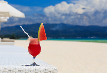 watermelon cocktail on blue tropical beach