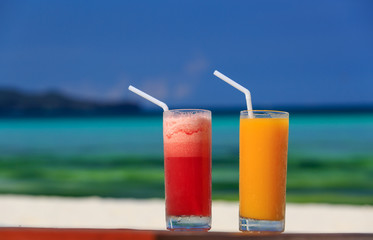 mango and watermelon cocktails on tropical beach
