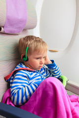 little boy with headset in flight