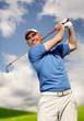 .golfer shooting a golf ball