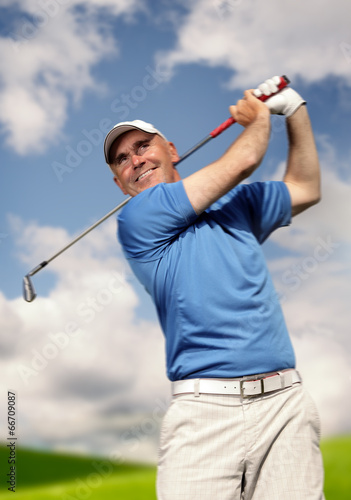 canvas print picture .golfer shooting a golf ball