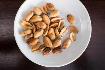 Salt roasted peanut in white plate