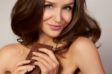 Young beautiful girl holding a chocolate, diet, healthy eating