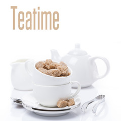 utensils for teatime and brown sugar, isolated